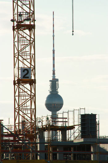 Berlin in change Berlin Berlin Photography City Change Industrial Industrial Photography Industry Urbanization Architecture Building Exterior Building Site Built Structure Change City Crane Day Industrial Landscapes Low Angle View Modern No People Outdoors Technology Television Tower Tower Urban Discover Berlin
