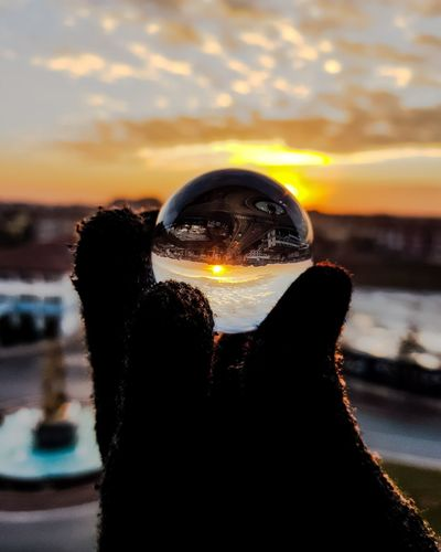 Lensball Sunset Hand City Gramslayers Sunset Water Reflection Close-up Focus On Foreground Sky Point Of View Day Outdoors Cloud - Sky