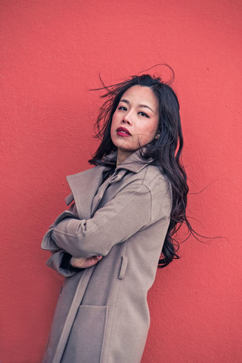 Pretty asian woman in front of a red wall Asian  Fashion Adult Beautiful Woman Clothing Colored Background Colorful Hair Hairstyle Lifestyles Long Hair Looking At Camera Model One Person Portrait Pretty Girl Red Red Wall Sexygirl Standing Three Quarter Length Wall - Building Feature Women Young Adult Young Women Visual Creativity This Is My Skin The Portraitist - 2018 EyeEm Awards The Fashion Photographer - 2018 EyeEm Awards