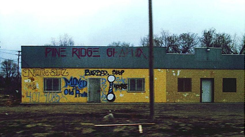 Store Sign. Pine Ridge Reservation Pine Ridge Spray Paint Graffiti Barber Shop South Dakota Abandoned