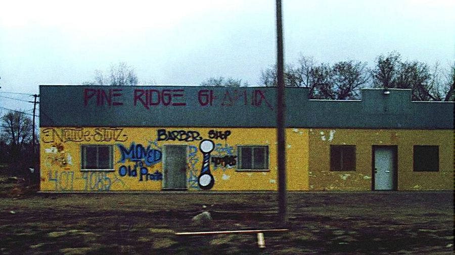 Store Sign. Pine Ridge Reservation Pine Ridge Spray Paint Graffiti Barber Shop South Dakota Abandoned
