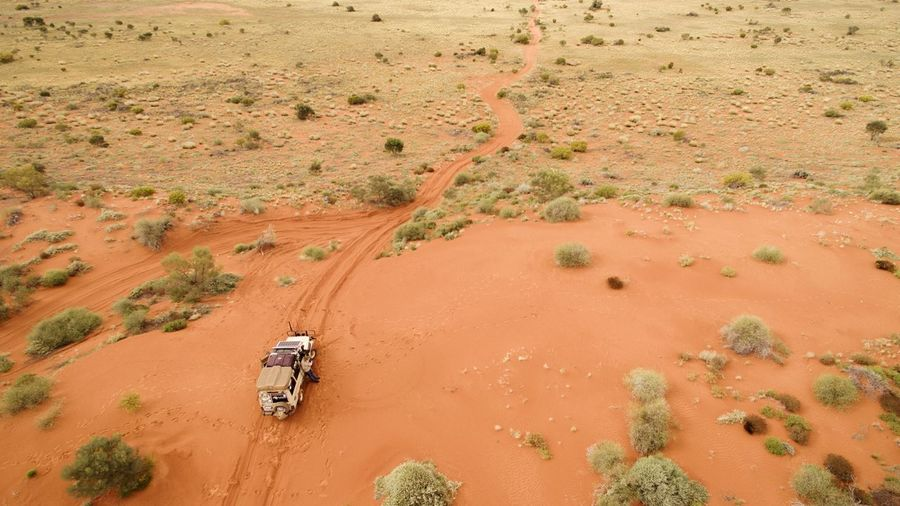 High Angle View Of Vehicle On Sand In Desert