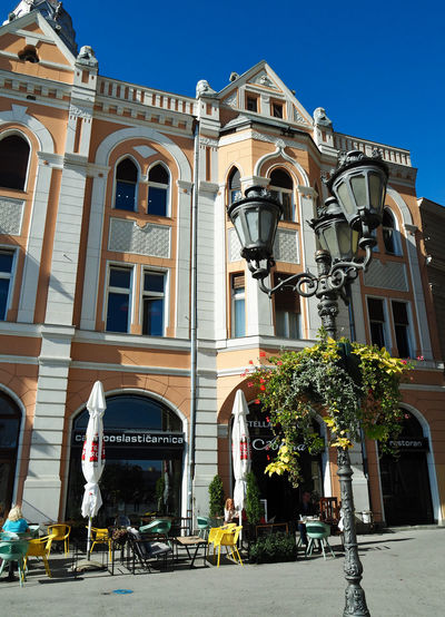 European Cities Novi Sad Serbia Eastern Europe Balkans Europe Outdoors Public Places Leisure Activity Pedestrian Walkway Building Exterior Architecture Built Structure Building City Real People Day Street Window Sunlight History The Past Lamp Post Outdoor Cafe People