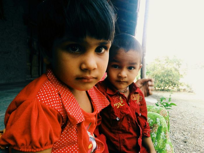 Close-up portrait of siblings outdoors