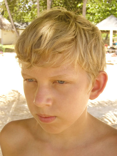 bored boy - on the beach Beach Beach Hut Blond Hair Bored Boredom Boy Caucasian Child Childhood Close-up Facial Expression Headshot High Angle View Looking Into The Future Nature One Boy Only Portrait Pre-adolescent Child Real People Serious Shirtless Summer Sunlight Tan Tobago