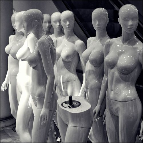 Close-up of statues in store