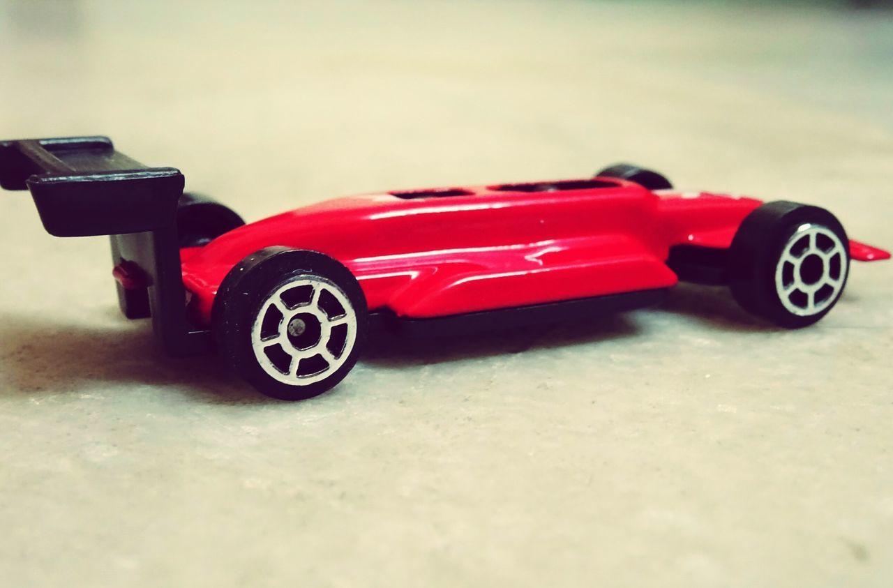 red, toy, toy car, transportation, land vehicle, car, childhood, racecar, no people, sport, motorsport, close-up, day, outdoors