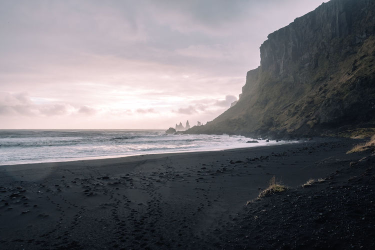 Beach Sea Water Sky Land Beauty In Nature Scenics - Nature Cloud - Sky Tranquil Scene Sand Tranquility Horizon Over Water Horizon Mountain Outdoors No People Motion Idyllic Sunset Nature Reynisdrangar Reynisfjall Iceland Reynisfjara Reynisfjara Beach
