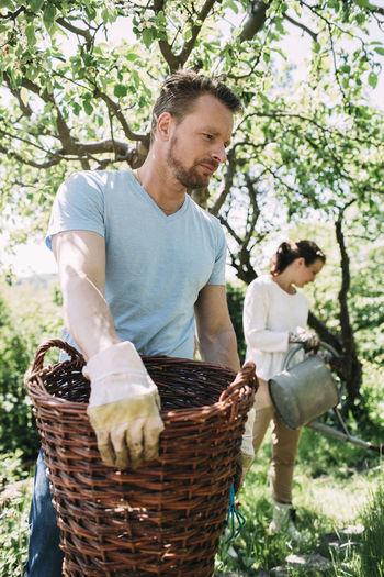 Man holding ice cream in basket