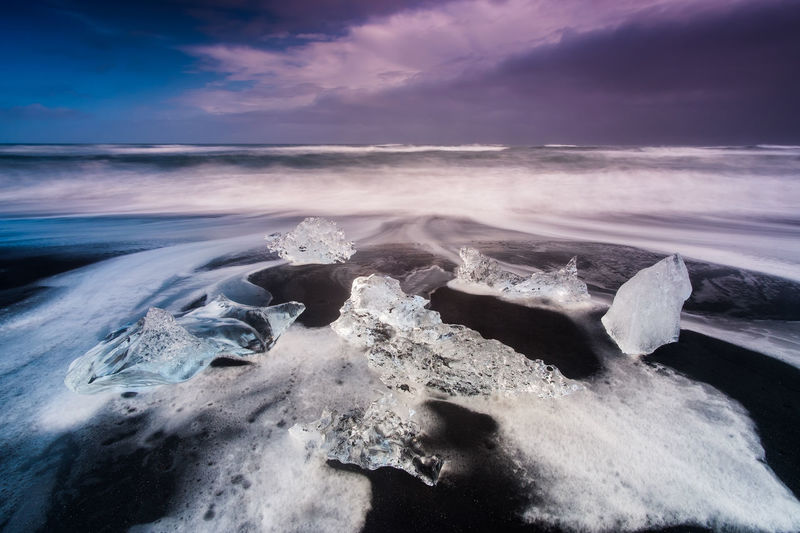 The Diamond Beach in Iceland. Iceland Beauty In Nature Cloud - Sky Cold Temperature Day Diamond Beach Frozen Horizon Over Water Ice Iceberg Idyllic Landscape Motion Nature No People Outdoors Physical Geography Scenics Sea Sky Tranquil Scene Tranquility Water Wave Winter The Great Outdoors - 2018 EyeEm Awards