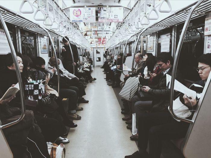 People in illuminated train