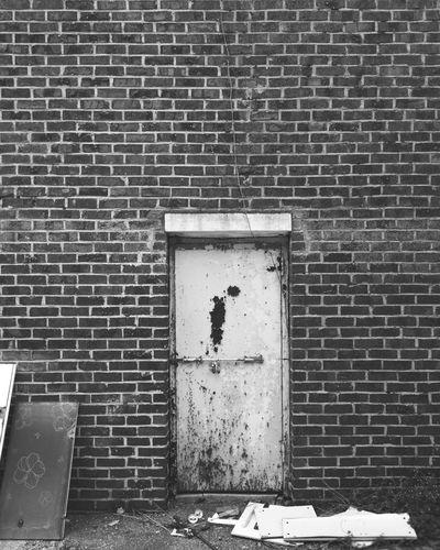 #wall #door Blackandwhite Gloomy Grey Rusty Architecture Building Exterior Built Structure Closed Door Wall Brick Wall Tiled Wall Closed Door
