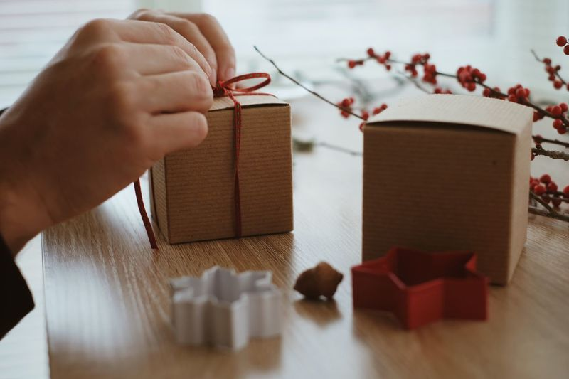 Gift Wrapping Gift Eye4photography  Christmas Decoration Decoration Xmas Decorations Holiday Memories Celebrations Gift Box Hands At Work Holiday Celebration Holidays DIY Christmas Time Christmastime Human Hand Hand Human Body Part One Person Real People Holding Indoors  Lifestyles Leisure Activity Close-up Holiday Moments Moments Of Happiness