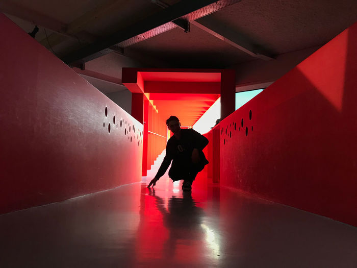 Red Dimension Bright EyeEm Best Shots Reflection Shadows & Lights Silhouette Ambiance Architectural Column Architecture Bold Built Structure Ceiling Illuminated Indoors  Leisure Activity Lifestyles Men One Person Real People Red