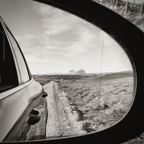Objects in the mirror Blackandwhite Monochrome Scotland Highlands Suilven Coigach Nc500 North Coast 500 Driving Road Road Trip Reflection Water Sea Beach Sky Close-up Side-view Mirror Vehicle Mirror Car Point Of View Car Vehicle Vehicle Part Land Vehicle