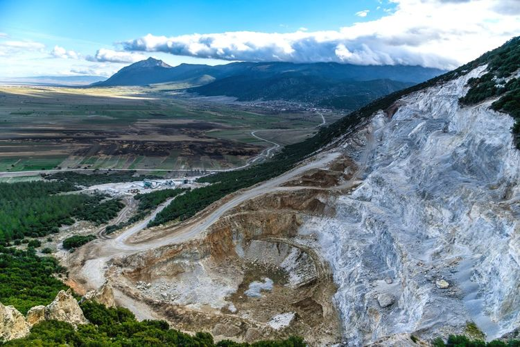 Destroyed side of mountain for marble quarry Nature Destruction Marble Quarry Marble Mountain Landscape Nature Scenics Sky