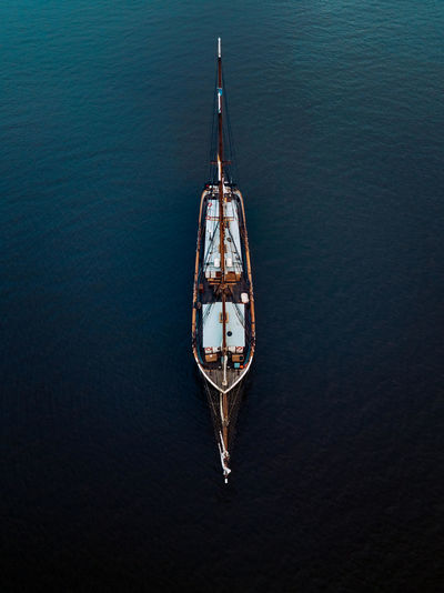 Water Nautical Vessel High Angle View Transportation Mode Of Transportation Waterfront Sea Nature No People Day Tranquility Beauty In Nature Travel Outdoors Tranquil Scene Rippled Scenics - Nature Sailboat Luxury Rowboat