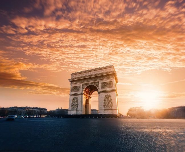 Triumphal arch against sky at sunset