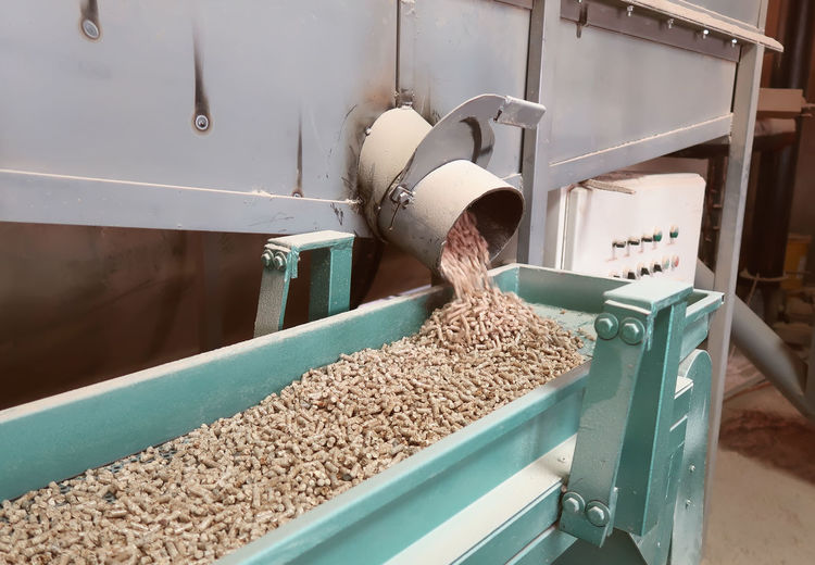 Meat spilling from machinery in container