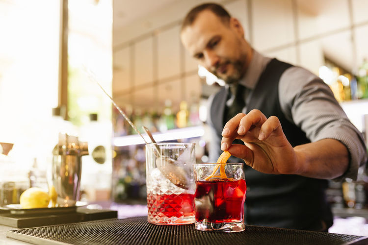 Bartender Preparing Cocktail At Bar