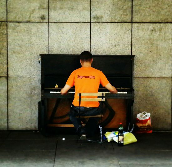 Colors And Patterns Sitting Musical Instrument Men Prague Photography Themes EyeEm Best Shots EyeEmBestPics EyeEm Gallery Contrast Of Shadows City Outdoors Streetmusic Streetmusician Playpiano Piano Jägermeister Orange Street Life Streetartist Cool Classicmusic Urban Praga