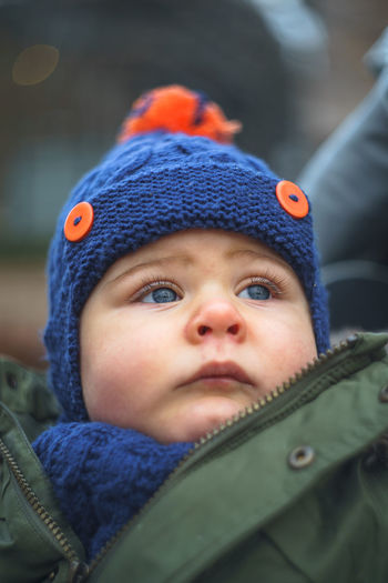 Baby Babyboy Blue Eyes Innocence Navy Blue Babyhood depth of field Focus On Foreground Headshot Knit Hat Navy Green Orange Color Portrait Toddler  Toddler Boy Toddlerlife Warm Clothing