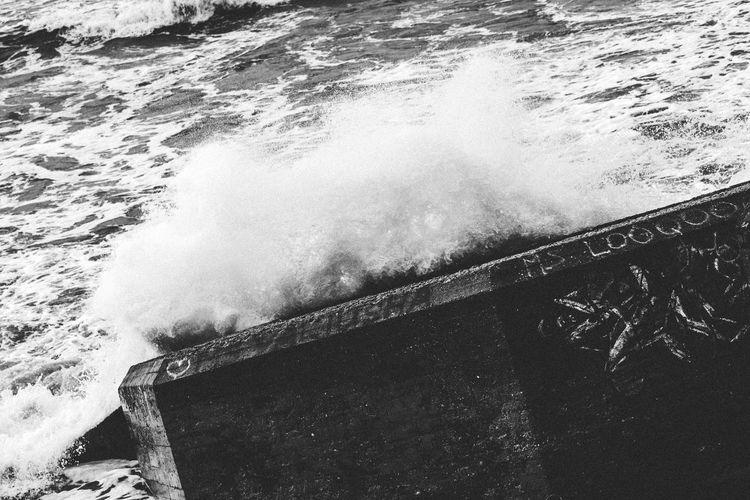 High angle view of sea waves splashing on shore