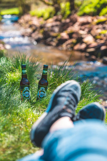 Tuborg by fishing in German mountains, in Schwarzwald Exploring Fun Low Section Water Human Leg Shoe Bottle Close-up Grass Personal Perspective Beer Bottle Beer - Alcohol Lager Brewery Hiker Shining Blooming