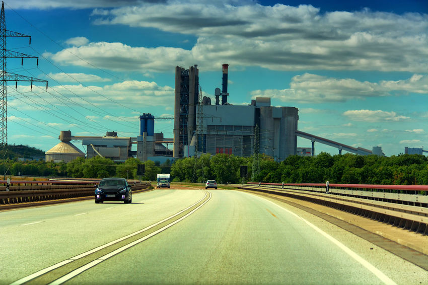 Power station near motorway in Germany Transportation Built Structure Sky Architecture Industry Building Exterior Factory Cloud - Sky Smoke Stack Mode Of Transportation Road Car Nature City Land Vehicle Motor Vehicle Day No People Fuel And Power Generation Outdoors Pollution Air Pollution