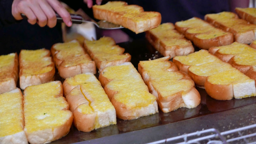 BBQ Garlic Herb Toasted Baked Barbecue Butter Close-up Dessert Food Food And Drink Freshness Garlic Bread Grilled Hand Human Hand Indulgence Ready-to-eat Sliced Yellow Yellow Color Paint The Town Yellow