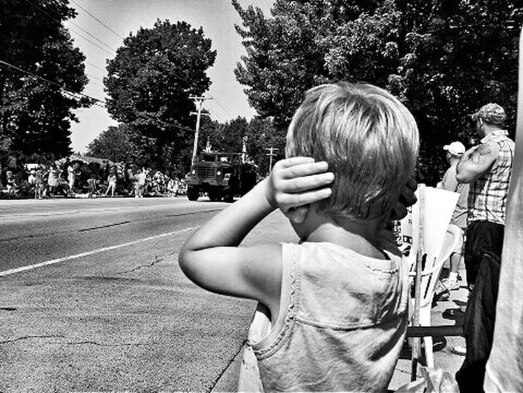 Boy covering ears at a parade Blackandwhite Photography Black And White NEM Black&white Black & White Childhood Memories Summer Summertime Parade Parade Time Parades Blackandwhite Black&white Childhood Kids Boy Kids Having Fun Colors Children Photography Having Fun Son Child Americana America July 4th Forth Of July