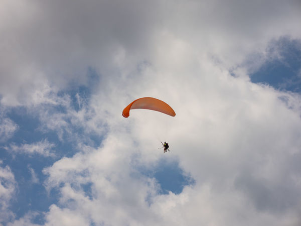 Adventure Cloud - Sky Day Exhilaration Extreme Sports Flying Freedom Joy Leisure Activity Lifestyles Low Angle View Mid-air Nature Outdoors Parachute Paragliding Parasailing People Sky Skydiving Sport Transportation Unrecognizable Person
