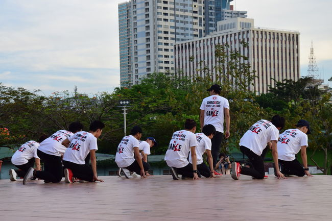 Rehearsing a dance Boys Buildings & Sky City Life Dance Dance Team Leisure Activity Lifestyles Outdoors People Dancing Rehearsal Teenagers  Trees