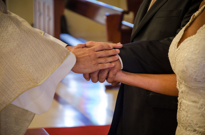 Blessing of the rings: hands of the priest and hands of the united couple Altar Architecture Blonde Christian Church Couple Cross Gold Groom Love Wedding Agreement Background Bible Black Bride Ceremony Holding Holy Love ♥ Newlywed Orthodox Prayer Religion Symbol