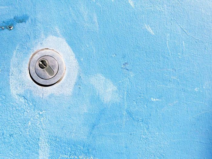 Full frame shot of lock on blue wall