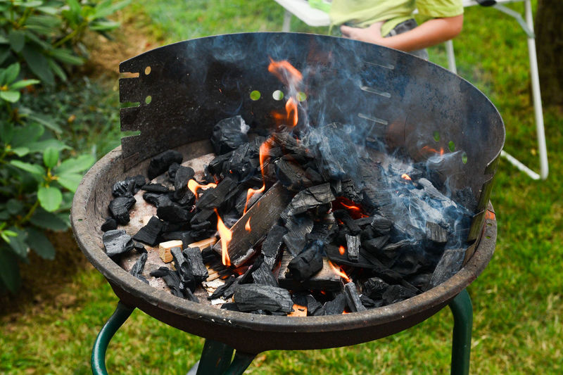 Close-up of firewood on barbecue grill in yard