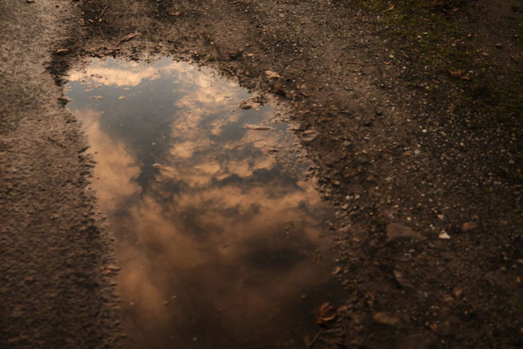 Reflection of sky on puddle