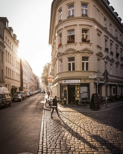 round corner / from a sunny morning Architecture Street Building Exterior Cobblestone City Built Structure Outdoors Sunlight Day Road Real People Sky Clear Sky Men People Berlin Streetphotography