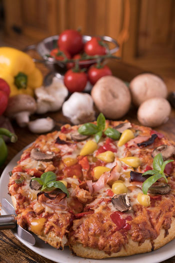 Pizza Basil Garlic Mushrooms Arranges Bacon Cheese Close-up Day Food Food Still Life Foodphotography Fresh Freshness Indoors  Indoors  Meat No People Paprika Pepperoni Pizza Ready-to-eat Table Tomatoes Vegetables Wood - Material