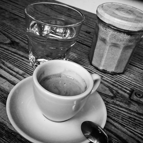 espresso in monochrome with sugar and water Arrangement Beverage Cafe Cultire Close-up Coffee Coffee Coffee Beans Coffee Cup Cup Directly Above Drink Espresso Espresso Cup Food And Drink Freshness Healthy Lifestyle Indoors  Latte Monochrome Preparation  Refreshment Saucer Spoon Still Life Table