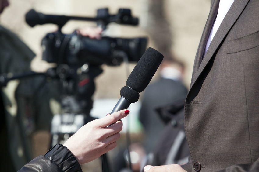 An interview for television Interview Mic PR Press Reporting Broadcasting Journalism Close-up Communication Conversation Interviewee Interviewing Journalism Journalist Media Media Equipment Media Interview Microphone Public Relations Publicity Recording Reporter Television Tv Tv Camera Unrecognizable Person
