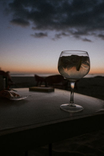 Beach Close-up Cloud - Sky Cuddle Drink With A View Drinking Glass Dune Dust End Of The Day Freshness Friendship Love Nature Night No People Outdoors Romance Romantic Sand Sitting Outside Sky Sun Goes Down Sunset Togetherness