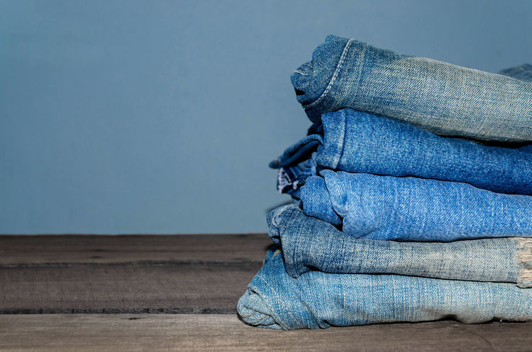 Blue jean and jean lack texture on the wooden floor, Pattern of blue jeans are overlapping on the table and free space. Jeans Blue Blue Jeans Close-up Day Jean Jeans Lack Lack Nature No People Outdoors Overlap Overlapping Pattern Texture Wooden