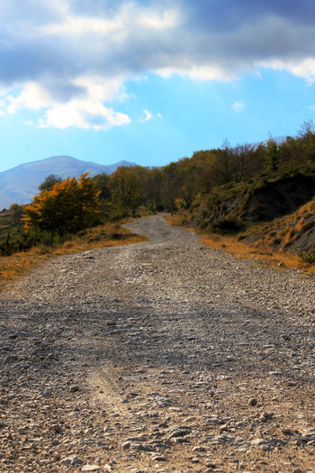 Abruzzo Cloud Cloud - Sky Cloudy Country Road Day Diminishing Perspective Landscape Mountain Nature No People Non Urban Scene Outdoors Road Roadtonowhere Rocks Sky Surface Level The Road Ahead The Way Forward Tranquility Tree Trees Vanishing Point
