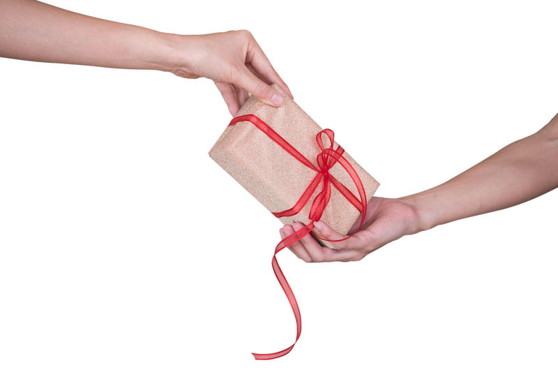White Background Studio Shot Hand Human Hand Human Body Part Holding Indoors  Red One Person Cut Out Copy Space Close-up Women Ribbon Ribbon - Sewing Item Body Part Finger Human Finger Unrecognizable Person Human Limb