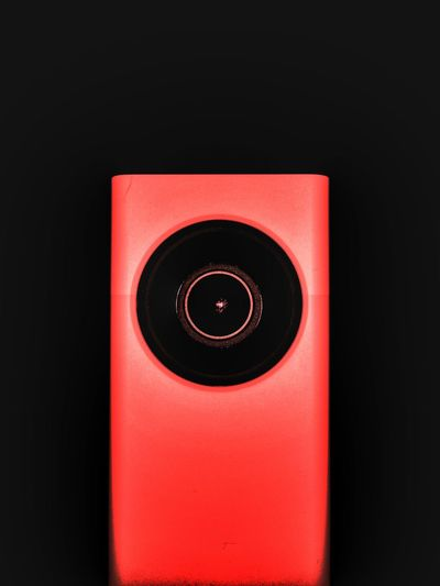 Close-up of red light over black background
