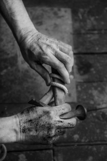 Adult Black And White Photography Close-up Day Dirty Hands Focus On Foreground Hamer Holding Human Body Part Human Hand Men One Man Only One Person People Real People Rope Wooden Floor Work Tool Worker Worker And Tools Working Working Hands Working Man Workshop