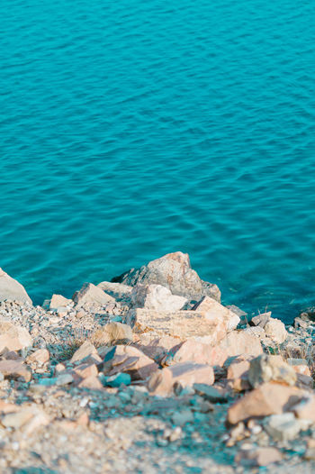 Water Sea Blue Rock Solid Day Rock - Object Beauty In Nature Nature No People Tranquility Outdoors Land Scenics - Nature Beach Tranquil Scene Idyllic Sunlight High Angle View Turquoise Colored