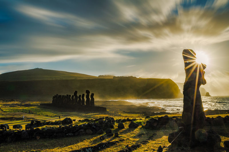The Travelling Moai Easter Island (Rapa Nui) is one of the most remote and mysterious destinations on the planet with a unique images are captured over the course of a day, with sunrise at Ahu Tongariki, afternoon vista from Rano Raraku and sunset at Ahu Tahai. Easter Island Isla De Pascua Moai Rapa Nui Ahu Cloud - Sky Nature Sky Sunrise Travel Travel Destinations The Traveler - 2018 EyeEm Awards
