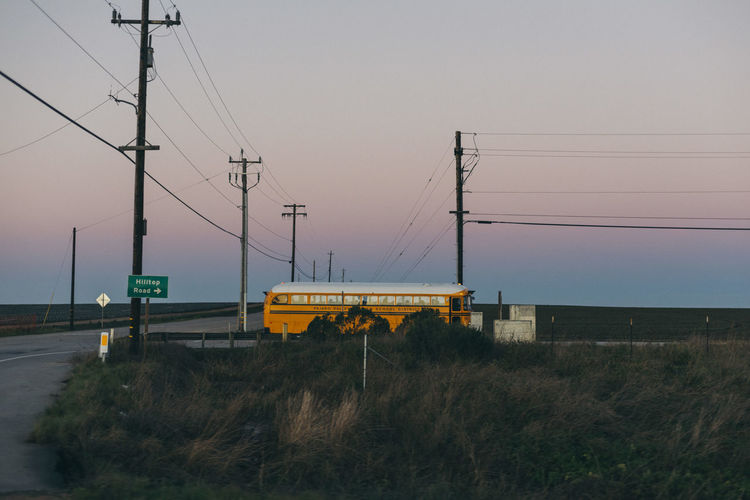 Cable Clear Sky Connection Day Electricity  Electricity Pylon Field Nature No People Outdoors Power Line  Rail Transportation School Bus Sky Technology Train - Vehicle Transportation EyeEmNewHere
